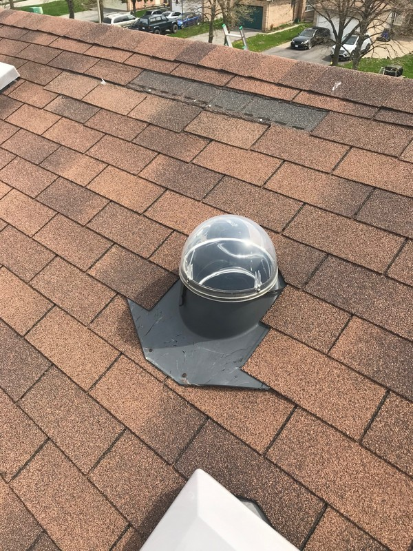 Roof repair to solar skylight on roof in Ajax