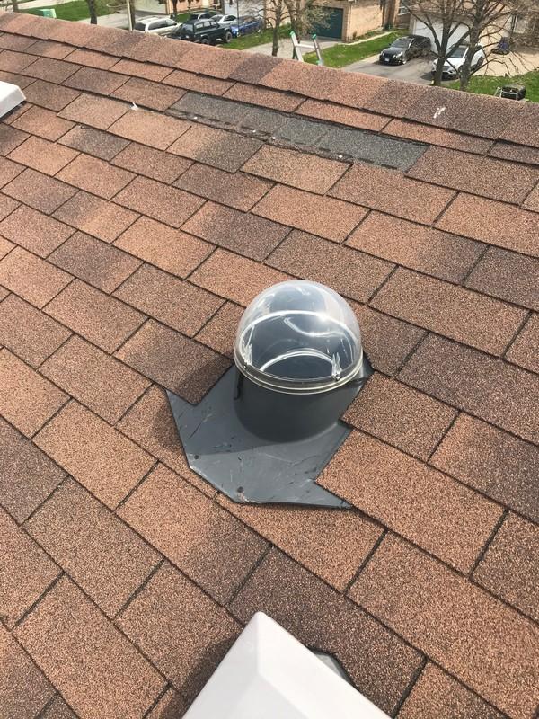 Roof repair to solar skylight on roof in Ajax