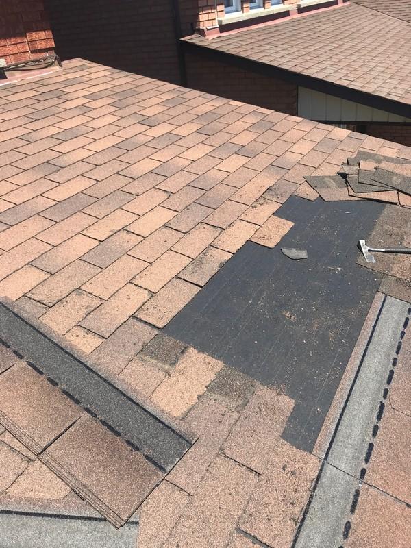 Strategic roof repairs on garage in Vaughn