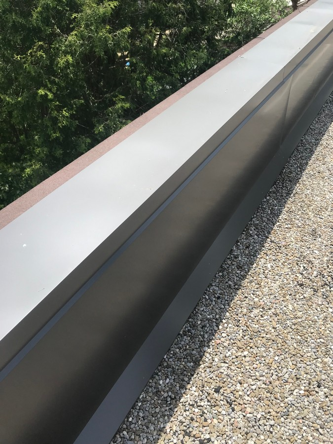 Sheet metal coping at parapet wall on commercial property in Scarborough