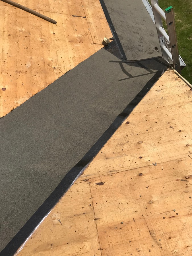 Ice and water installation on residential roof replacement in Scarborough