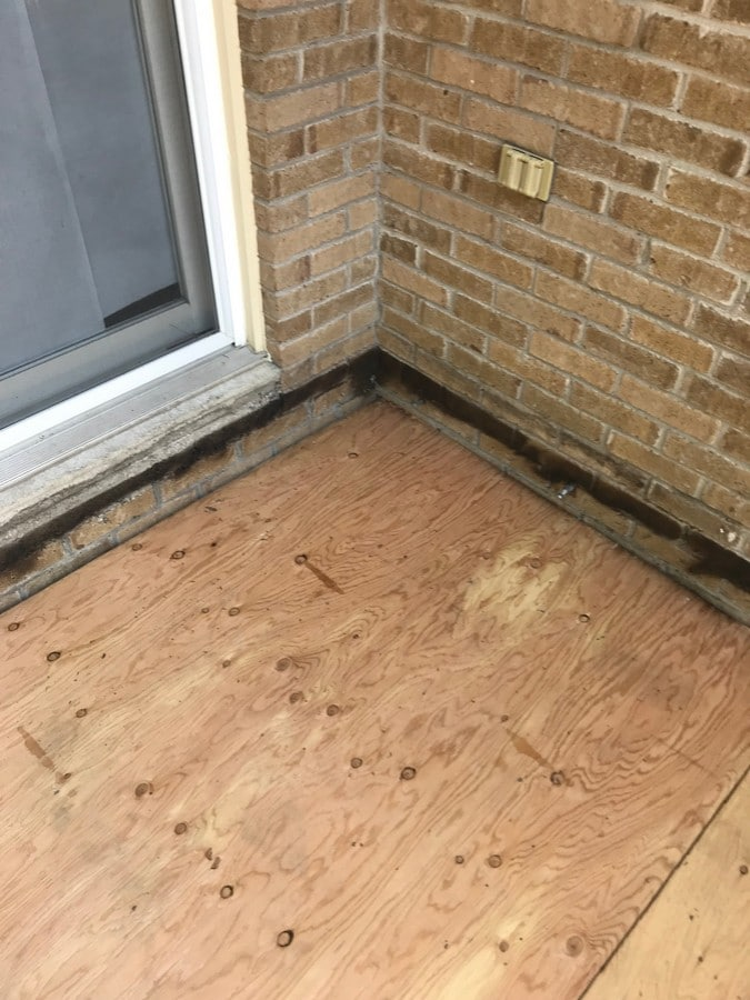 Elastocol stick applied to wood deck on flat roof in Pickering