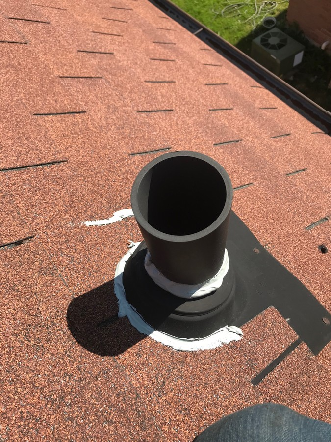 Sealing plumbing pipe with acrylic caulking on roof in Scarborough