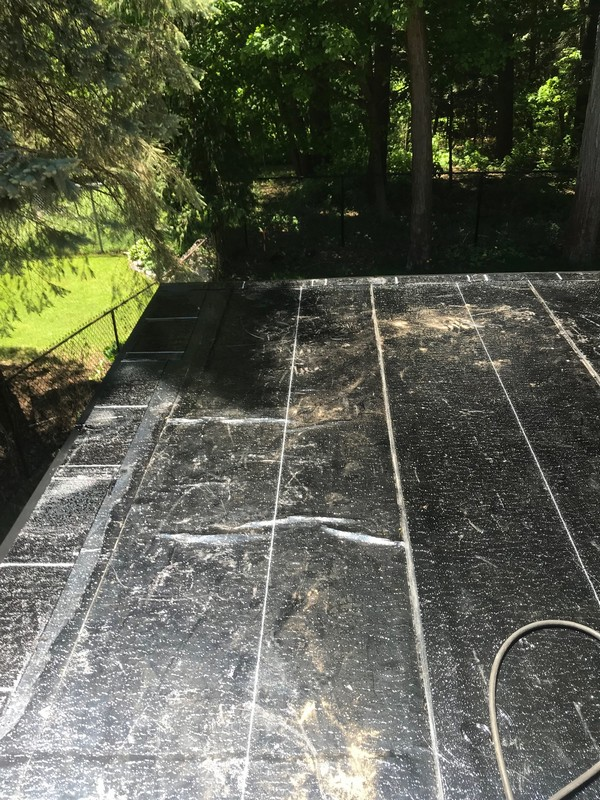 Sopralene Flam stick base membrane on flat roof addition in Pickering