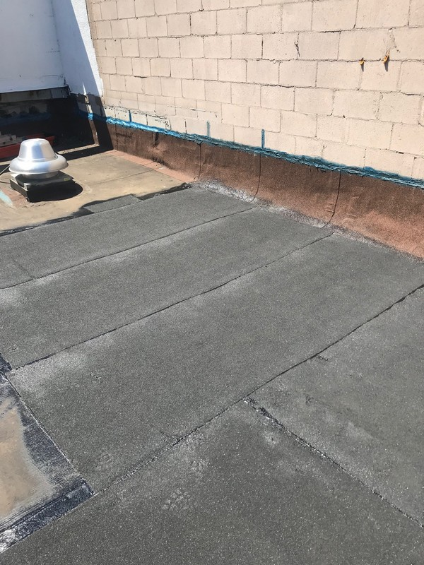 Torch applied SBS cap sheet over APP membrane roof in Toronto