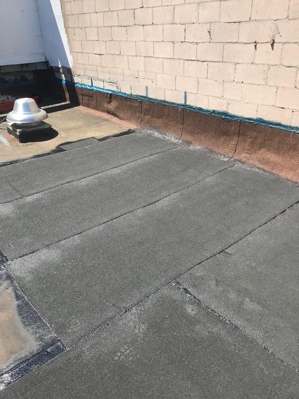 Torch applied SBS cap sheet over APP membrane roof in Toronto