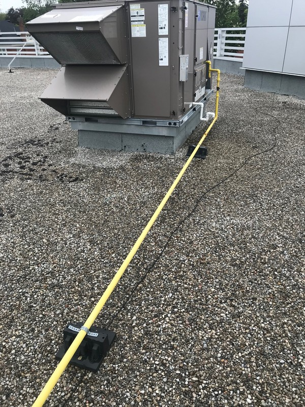 Repairs around gas lines on commercial roof in Burlington