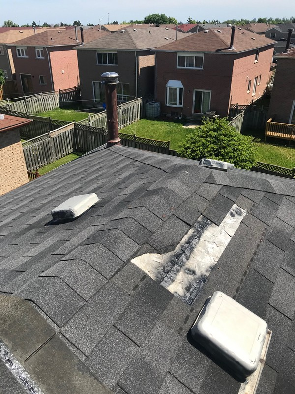 Windstorm damage to 3 tab Fiberglass shingles on roof in Markham