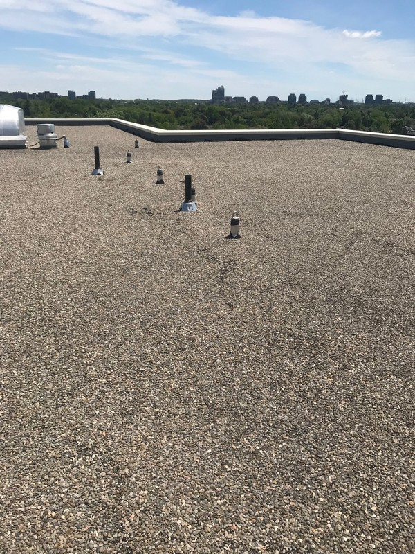 Roof repairs around roof anchors on retirement home flat roof in Vaughn