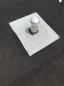 New insulated breather vent installed on flat roof in Scarborough