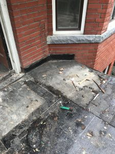 Demolition of flat roof balcony on home in Toronto