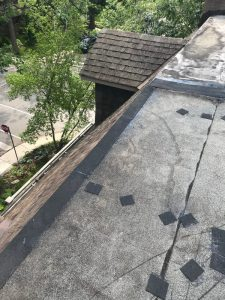 Flat roof repairs at drop flashing with mineral surfaces cap sheet in Toronto