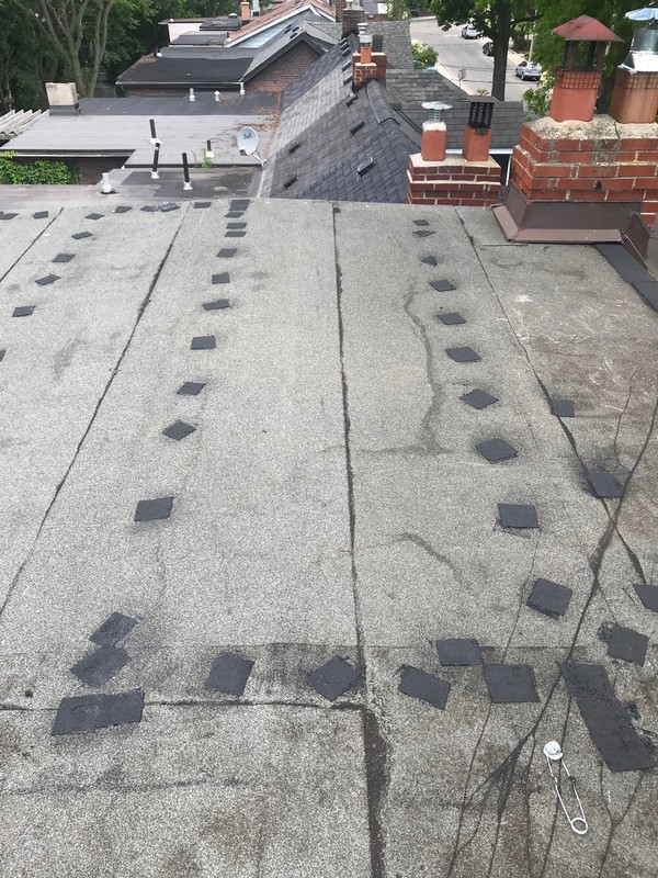 Strategic flat repairs using bitumen membrane in Toronto