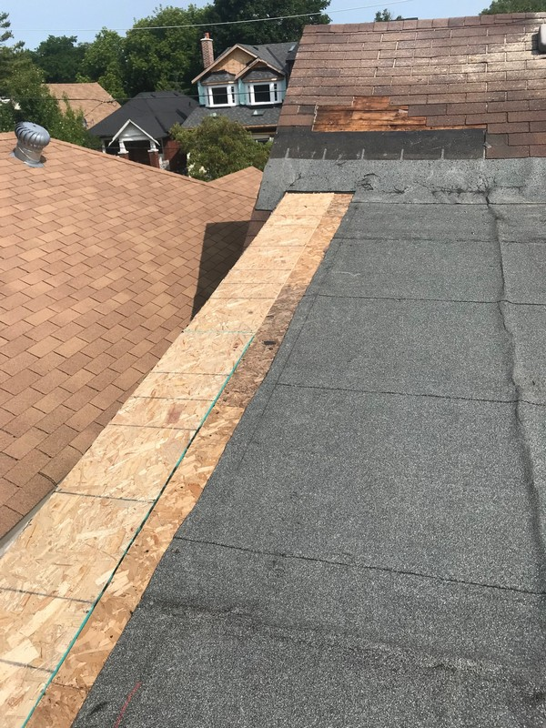 New 5/8 particle board sheathing installed on flat roof in Toronto