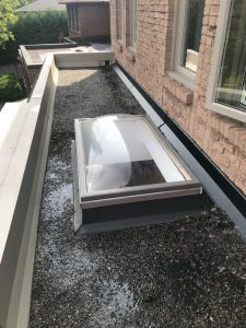 Flashing repairs to curb mount skylight on flat roof in Markham