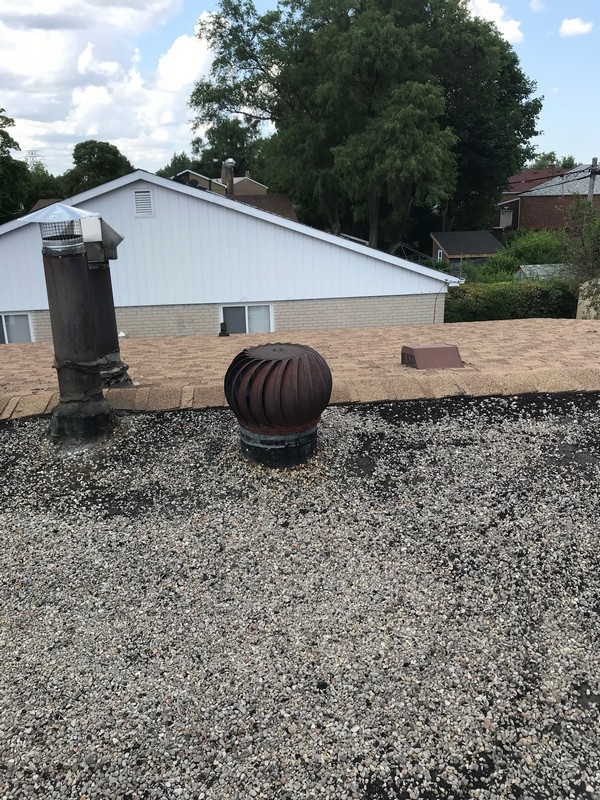 Tar and gravel repairs on flat roof using Non- fiberated roof emulsion in Scarborough