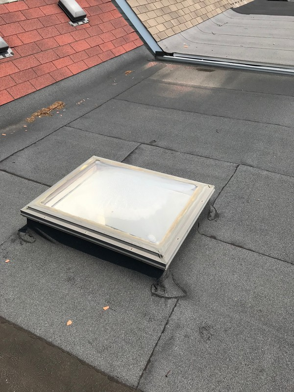 Skylight repairs on modified flat roof system in Toronto