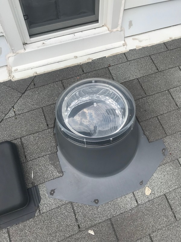 Solar skylight installation on flat roof in Scarborough