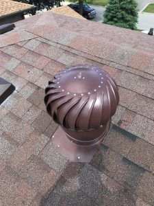 Whirley vent install on roof in Pickering