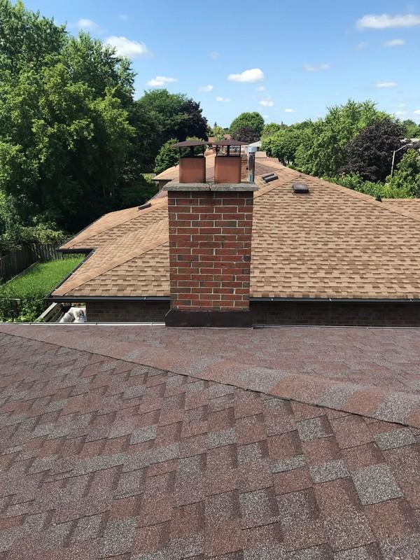 Sealing of metal flashing with caulking on roof in Pickering