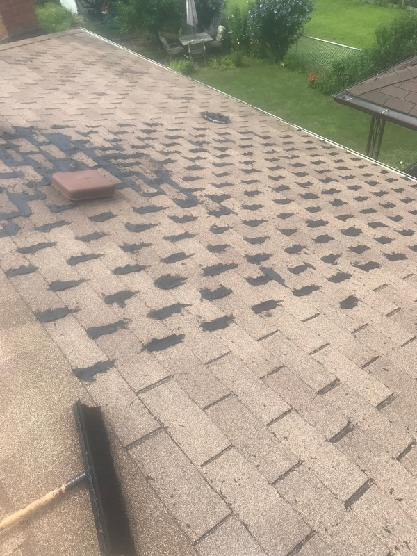 Strategic repairs to roof on home in Toronto using roof cement