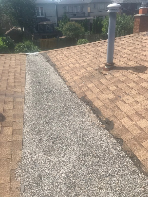 Flat roof repairs to tar and gravel pig valley in Toronto