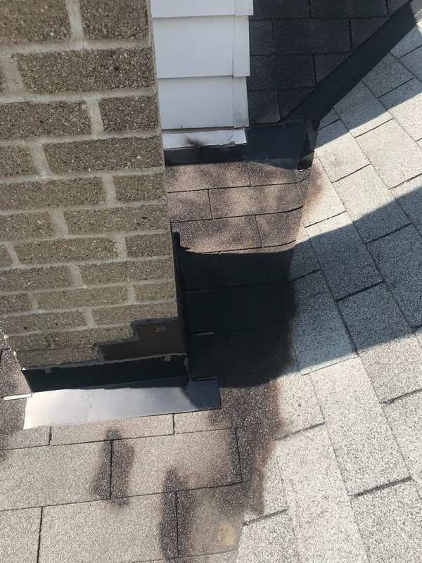 Roof repairs at chimney low slope roof in Toronto