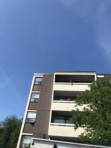 Flat roof repair on tar and gravel roof system in apartment building in Scarborough