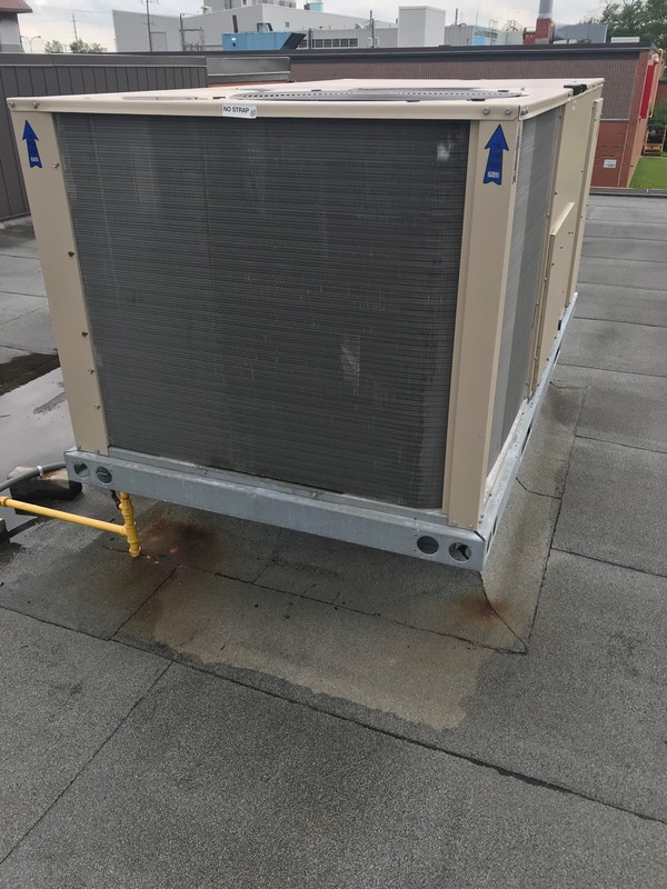 Flat roof repairs at curb mount AC unit on industrial flat roof in Ajax