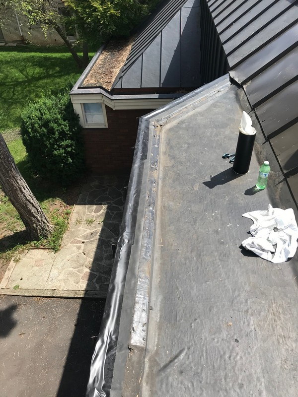 EPDM membrane repairs at parapet on flat roof in Etobicoke