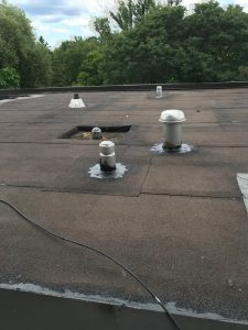 Repairs at insulated breather vent on flat roof with torch applied membrane