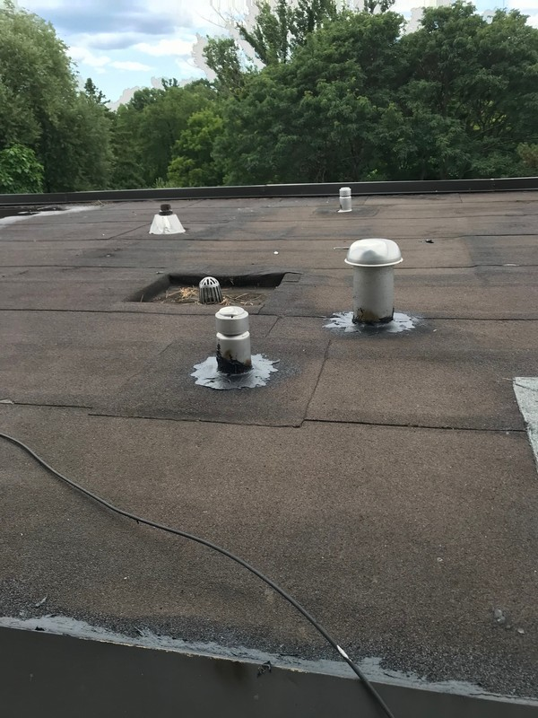 Repairs At Insulated Breather Vent On Flat Roof With Torch